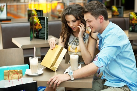 Young woman checking her shopping bag Stock Photo - 9942132