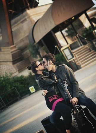Young handsome couple kissing  photo