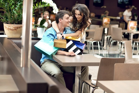 Young happy couple at the shopping center Stock Photo - 9941512