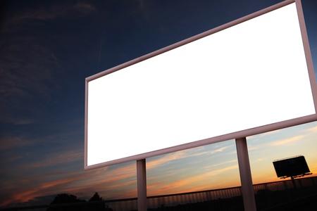 billboard posting: Blank billboard over city background Stock Photo