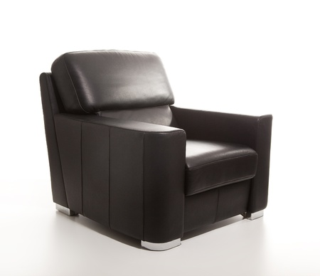 A studio shot of a leather black armchair isolated on white background photo