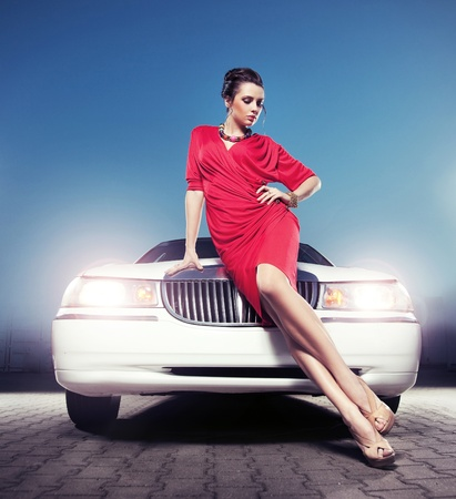 Sexy lady in front of a limousine photo