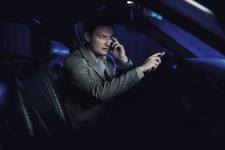 sportcar: Elegant man driving and talking over cellphone Stock Photo