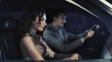 HAndsome pair driving at night photo
