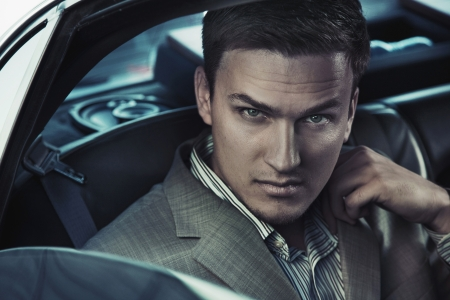 Portrait of a sexy man in the car Stock Photo - 9941647