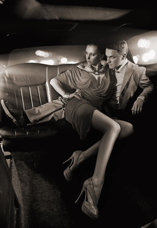 Handsome couple hugging in a luxury limousine photo