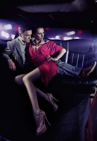 Handsome couple hugging in a luxury limousine Stock Photo - 9941640