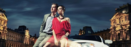 Colorful image of beautiful couple sitting in a limousine photo