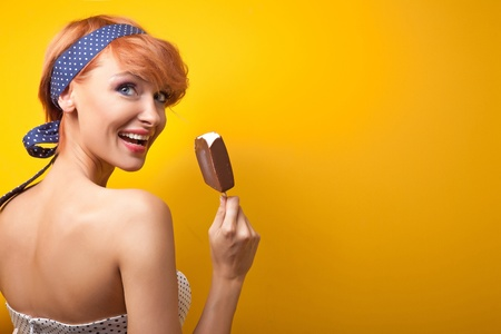 woman with ice cream: Happy woman eating ice cream