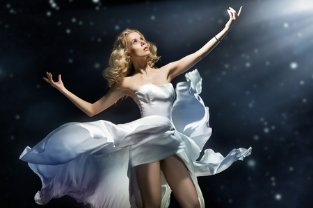 Blonde beauty posing over starry background photo