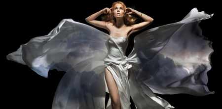 Gorgeous female model wearing white dress photo