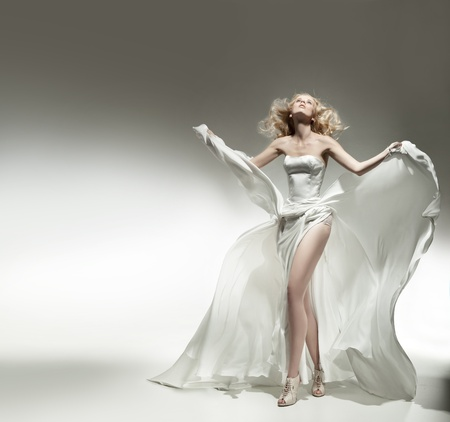 Romantic blonde beauty wearing white dress photo