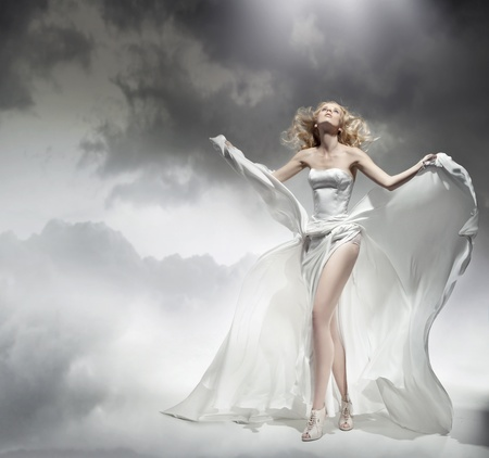 Romantic blond beauty posing in amazing dress photo