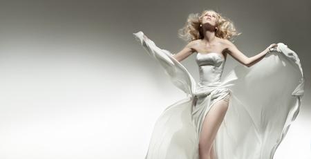 classy woman: Beautiful sexy young woman wearing white dress Stock Photo