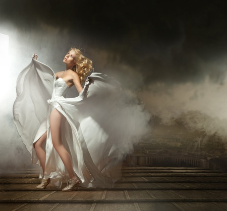 wind dress: Art photo of a sexy woman in beautiful dress