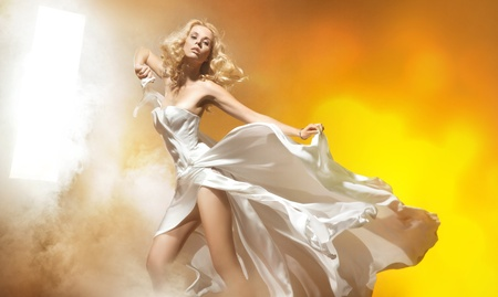 wind dress: Sexy blond woman in amazing dress posing