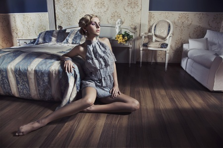 Photo of blonde beauty posing in vintage room Stock Photo - 9965212