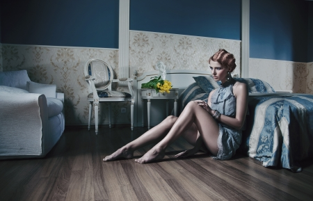 Red haired woman in stylish room photo