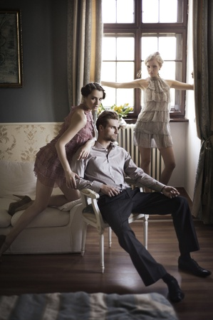 life partners: Young male and female models posing in a stylish interior Stock Photo
