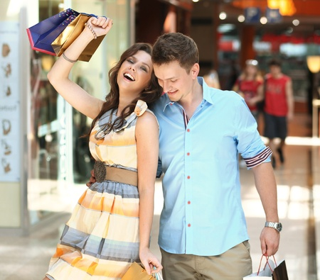 Cheerful couple in a shopping center photo