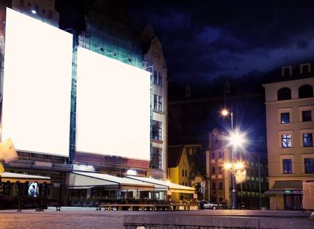 publicity: empty white board over city night background