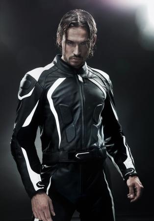 red leather: Handsome man wearing motorbike uniform