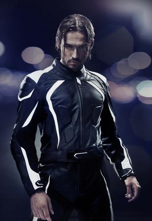handsome man: Stylish man wearing motorbike uniform
