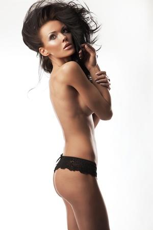 Beauty brunette posing on white background photo