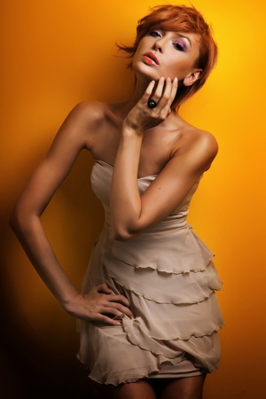 glamours: Fashion photo of beautiful redhead girl posing in sensual dress Stock Photo
