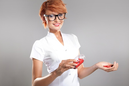 Photo of female doctor holding pills photo