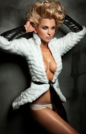 Sexy blond lady posing photo