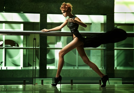 Amazing woman running in black sexy dress photo