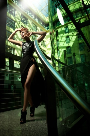 Sexy modern woman posing in black dress photo