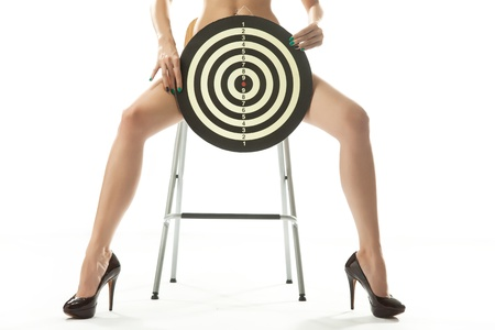 tall woman: Woman on chair with shooting target Stock Photo