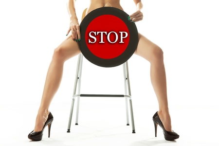 with stop sign: Conceptual photo of a woman holding stop sign Stock Photo