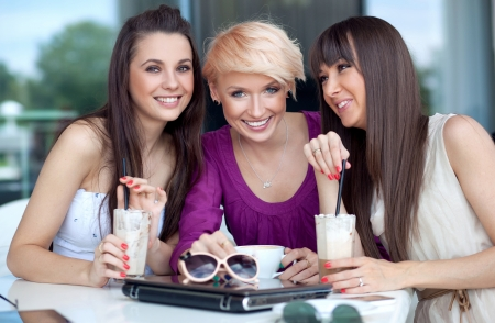 socializing: Three young women having coffee break Stock Photo