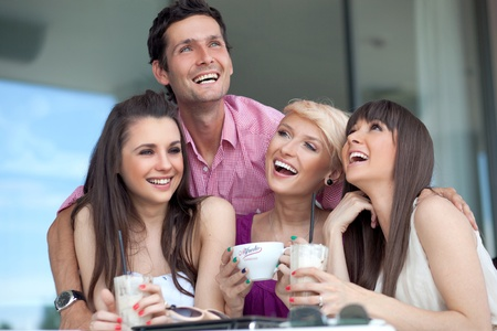 food court: Smiling young people Stock Photo