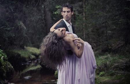 man carrying woman: Elegant man carrying woman