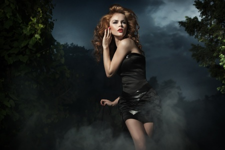Beautiful woman posing on evening background Stock Photo - 10827908