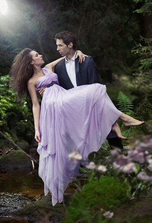 elegant lady: Handsome man carrying his woman Stock Photo