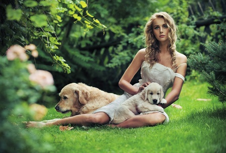 Cute woman with dogs in beauty nature scenery