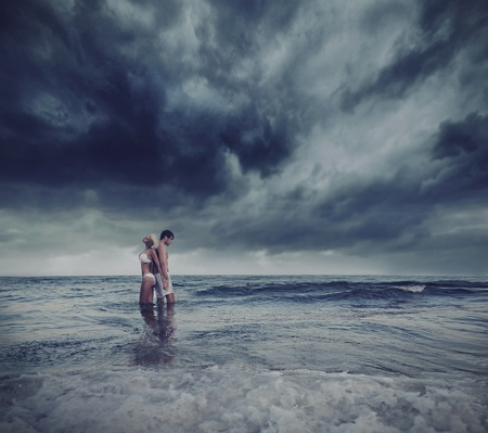intimacy: Hugging lovers in the sea