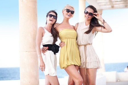 three persons: Young beauty friends on vacation day