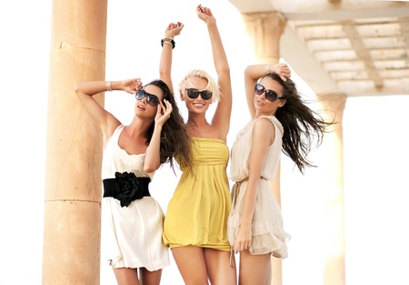 fashion  woman: Three cheerful women wearing sunglasses