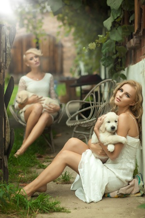 Two beauty ladies with cute puppies Stock Photo