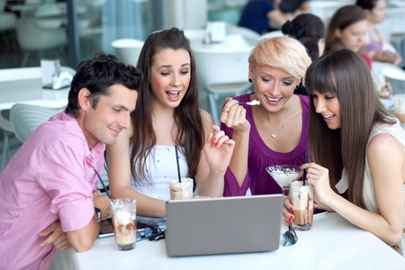 Young people browsing internet in a restaurant photo