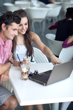 friends talking: Loving couple browsing internet in a restaurant