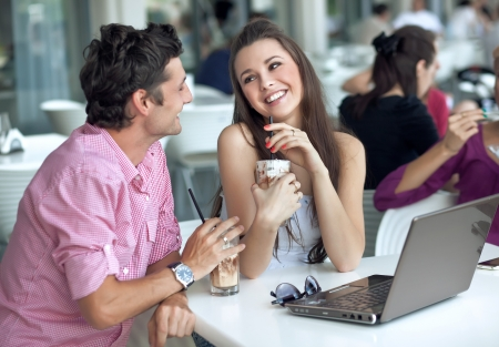 couple talking: Loving couple in a restaurant