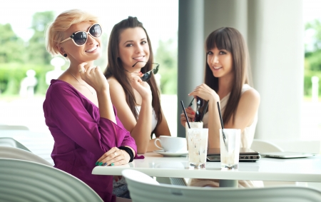 socializing: beautiful young friends Stock Photo