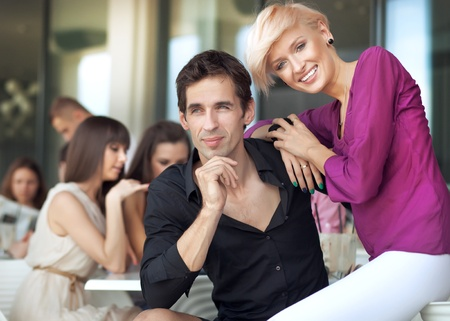 food court: Handsome man next to cheerful women Stock Photo